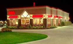 An architectural night shot of as Arby's restaurant